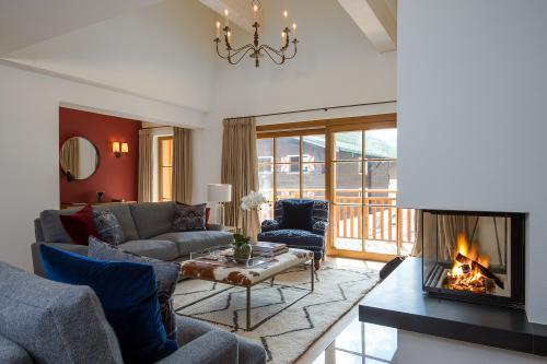 Thurnher's Residences - Apartment 5 - Wohnzimmer mit Kamin
